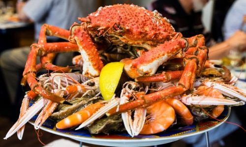 travel to France - atlantic crab on seafood plate in local fish restaurant in Treguier town in the Cotes-d'Armor department of Brittany